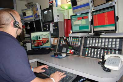 (1) Fire dispatchers must intently listen to all frequencies a firefighter can use to transmit a Mayday. Countless Mayday transmissions have gone unheard by the IC because of many factors on the fireground. (Photo by author.)