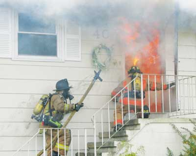 (1) There's more to fireground tactics than fire attack. (Photo by Ray Kline.)