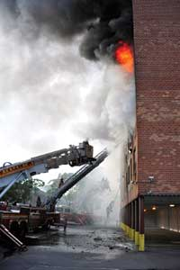 (4) Three ladder apparatus are in place addressing victim and firefighter safety.
