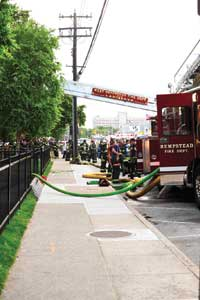 (5) A tower ladder is used to supply a fire department standpipe connection.