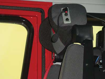 (12) Speakers and a small boom microphone in the seating headrest provide for crew communication without wearing headsets.