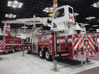 (13) The Rosenbauer T-Rex articulating aerial platform had a fully enclosed aerial operator's seat. The unit is being delivered to Canada.