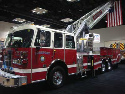 (21) A Sutphen 100-foot aerial without pump and tank to minimize height. This unit is only nine feet, three inches tall.