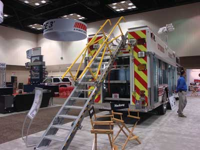 (22) Hackney's Auto-Deploy Staircase makes retrieving equipment from the rooftop compartments safe and easy.