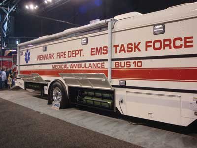 (30) The Sartin mass casualty response vehicle with several stretchers mounted to each wall.