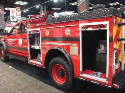 (32) APR Plastic Fabricating displayed a mini-pumper with plastic body and integral water tank.