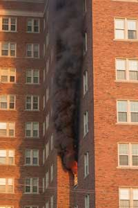 (1) Detroit firefighters arrive to find fire on the fourth floor autoexposing the apartment above.