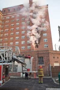 (6) Conversion of the fire is seen quickly after arrival of the first-due companies, and the other areas on the fire floor and floor above near the main stairwell only experienced moderate smoke conditions.