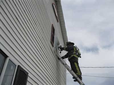 (3) While the entry firefighter is searching the room, the oriented firefighter stays on the ladder with the TIC at the window monitoring conditions while staying in voice contact with the entry firefighter and acting as his safety lookout.