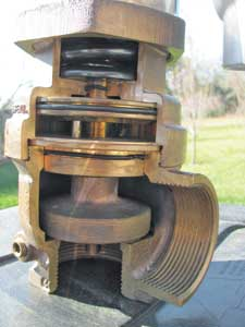 (20) A cut-away of a field-adjustable PRV that can be adjusted by tightening springs in the upper bonnet with a special adjustment rod. (Photo by Mac McGarry.)