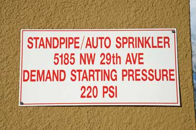 (24) A sign posted near the FDC indicates a pressure to pump combination standpipe/sprinkler system equipped with PRVs. If the building's fire pump fails, the fire department will have to pump 220 psi, even if firefighters were to use standpipe outlets on the first floor.