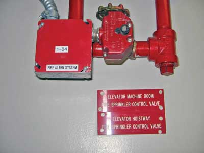 (25) Valves controlling the sprinklers in an elevator hoistway and machine room.