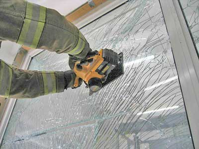 (27) Firefighters practice cutting laminated impact-resistant glass with a battery-operated circular saw. Cutting with battery-powered saws will be faster if the glass is first
