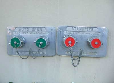 (3) This old high-rise building has separate sprinkler and standpipe systems. The plugs for the sprinkler system fire department connection (FDC) are green; the plugs for the standpipe FDC are red.