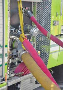 (7-8) To prevent injury if a hoseline bursts during high-pressure pumping, connect hoselines to discharges on the right side of the apparatus, not at the pump panel. As an added precaution, lash hoselines to the apparatus and FDC with nylon webbing.