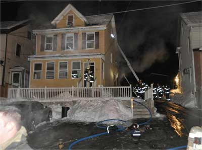 (1) In this private dwelling, firefighters discovered an apartment on the first floor, three single-room occupancies on the second floor, and an apartment in the attic. (Photo by Tom Bierds.)