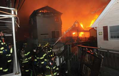 (1) Dozens of houses were already on fire in Breezy Point before FDNY arrived on the scene. (Photos 1-2 by Todd Maisel, NY Daily News via Getty Images.)