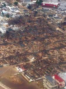 (3) A view of the Breezy Point, Rockaway, Queens conflagration from a Task Force Guardian copter during a US&R aerial recon. (Photo courtesy of the Federal Emergency Management Agency.)
