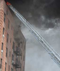 (1) Firefighters operating on fire escapes often ventilate windows by starting with the