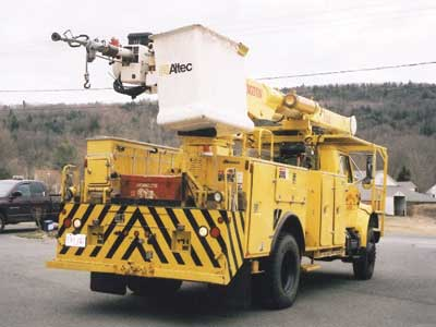 60-foot Altec 4 × 4 bucket truck features a large 2½-inch nozzle fed by a 2½-inch line, a heavy-duty winch for rescue work, and a breathing air line