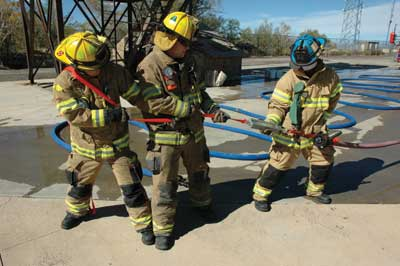 (3) Measuring the force needed to drag hose using a hanging weight scale.