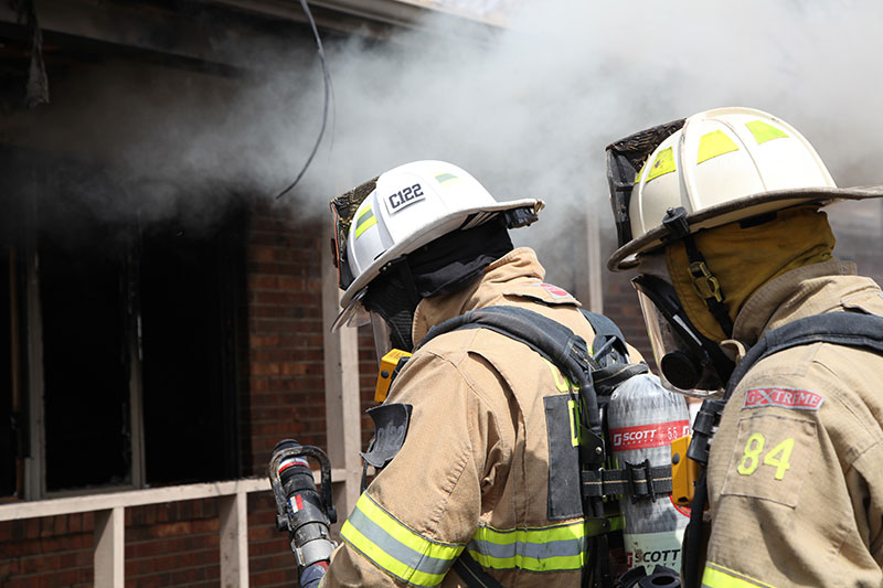 Nozzle in hand, firefighters stand by at the FDIC 2014 live burn.