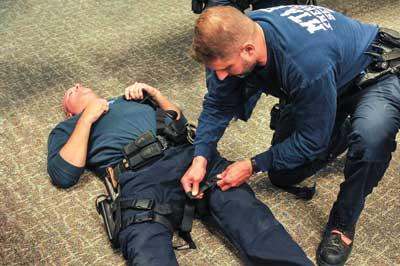 Law enforcement learning the techniques of Tactical Emergency Casualty Care.