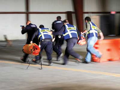 Law Enforcement and EMS learning the techniques of a coordinated response.