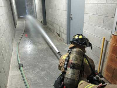 nozzle is flowed and the pressure adjusted before opening the door to the fire apartment