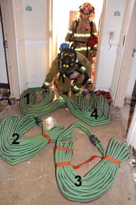 Four Denver load bundles of two-inch hose with 2½-inch couplings
