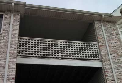 third-floor balcony with vinyl siding, vinyl ceiling, and a perforated vinyl soffit