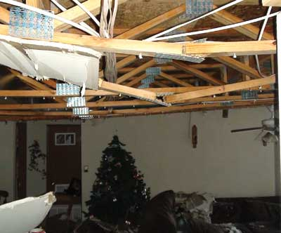 weight of the water broke this second-floor ceiling flat truss