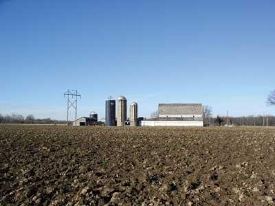 farm with four tower silos