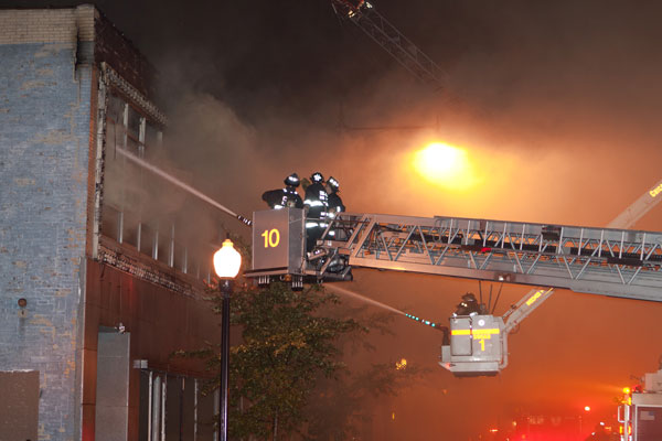 Aerials operating at a fire scene.