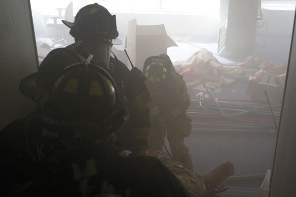 Firefighters during a search drill at a commercial building in Yakima, Washington.