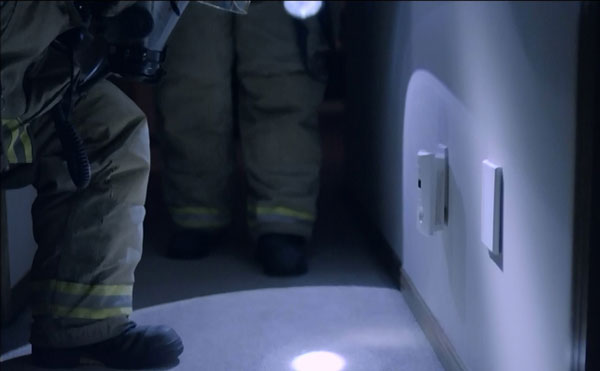 A still from the film showing firefighters and a detector.
