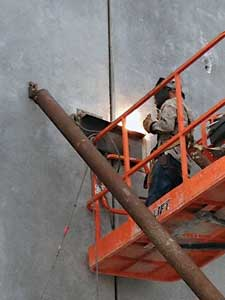 (1) Steel is arc welded to the steel embedded in the tilt-up wall sections.