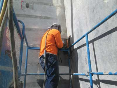 (2) A steel angle is welded to the steel in the wall sections to fasten them in the corners)