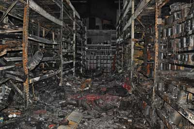 (2-3) The damaged storage racks in the paint department.