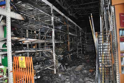 (2-3)The damaged storage racks in the paint department.