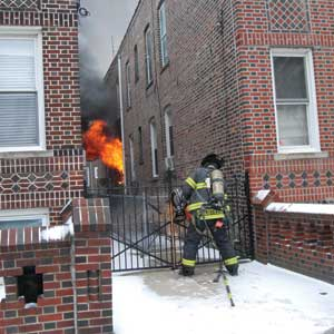 (2) The fire is self-venting and exposing the second floor of this building to the possible spread of fire.