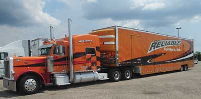 (2) Large vehicles, such as this moving van loaded with hydrocarbon-based solid fuels, can and will pose significant extinguishment challenges.