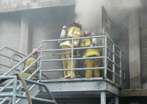 (1) Live fire training at the Class A burn building. (<i>Photo courtesy of VBFA.</i>)