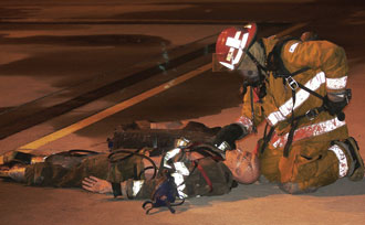 (2) A recruit drills on a Mayday response. (<i>Photo by Rayford Smith.</i>)