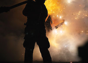 (4) A recruit extinguishes a car fire. (<i>Photo by Rayford Smith.</i>)