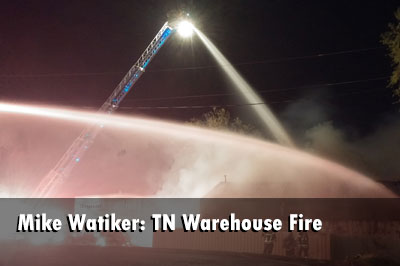 Firefighters extinguished a fire at a warehouse filled with vintage cars and collectible coin-operated machines.