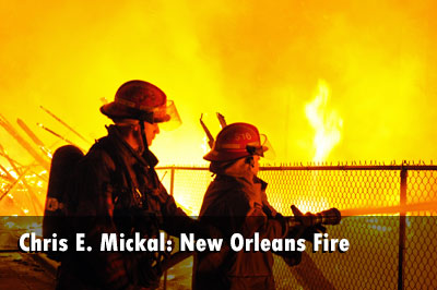 Chris E. Mickal has some photos of firefighters responding to a fire that burned three vacant dwellings.