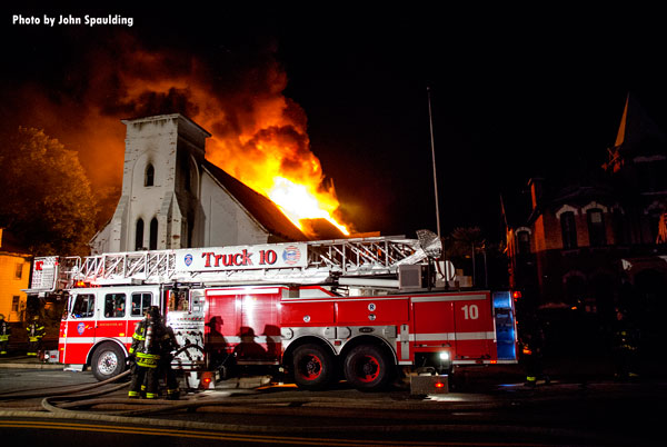 Fire apparatus parked in front of a burning church in Rochester, New York.