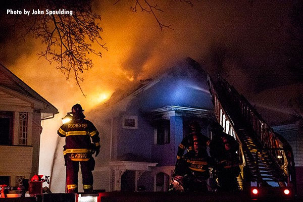 Firefighters at the scene of a house fire in Rochester, New York. Photo by John Spaulding.