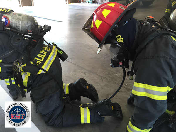 Firefighters training on buddy breathing techniques.